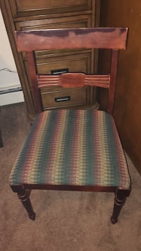Brown wooden framed green padded chair 3335 mi