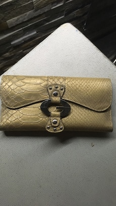 gold-colored snakeskin leather G by Guess clutch