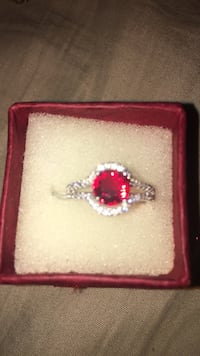 silver and red gemstone ring in box Kitchener, N2G 1N1