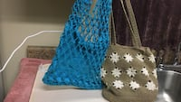 two blue and brown knit shoulder bags