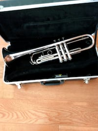 Trumpet with case, 4 mouthpieces, 6 mutes, 2 stands.