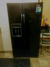 Whirlpool Tall large side by side frig/freezer. Baltimore, 21215