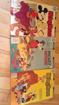 three Mickey Mouse comic books