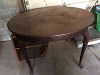 Round brown wooden pedestal table from a North Carolina furniture company , has two matching chairs! Geneva, 44041