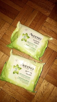 Two green aveeno wet wipes
