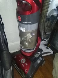 red and black Bissell upright vacuum cleaner Nitro, 25143