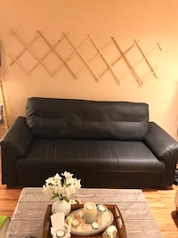 Black faux leather tufted sofa chair Coquitlam, V3E 3B7