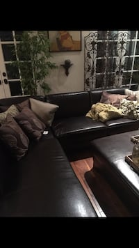 Brown fake leather sectional, damage on a few sections... easily covered with throw.  Los Angeles, 91356