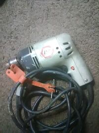 gray and red corded power drill