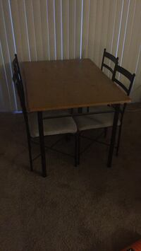 rectangular brown wooden table with four chairs dining set San Diego, 92117