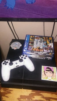 white Sony PS4 console with controller and game ca Bakersfield, 93306