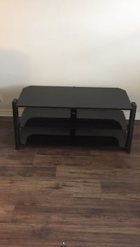 Black wooden framed glass top tv stand Ottawa, K1Y