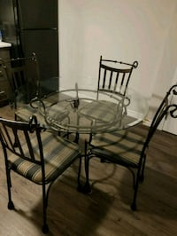 round glass-top table with four chairs 550 km