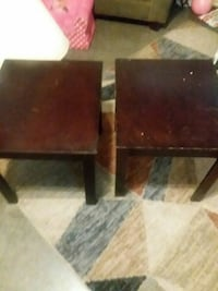 two square brown wooden side tables