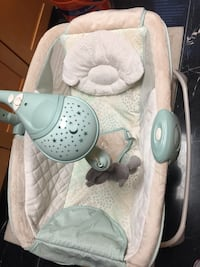 baby's white and teal bouncer