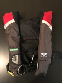 brown, red and white life vest 37 km