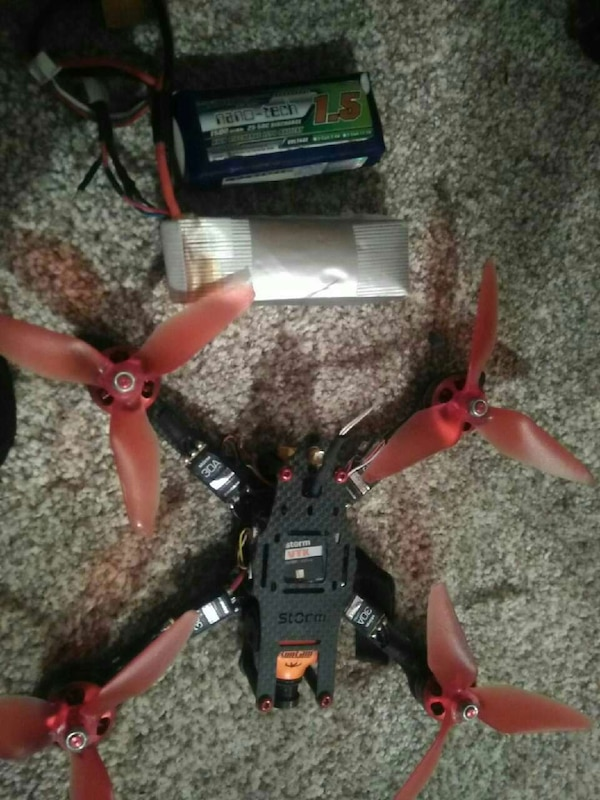 black and red radio control quad-copter
