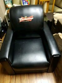 black leather padded armchair with brown wooden base Langley, V2Y 1B5