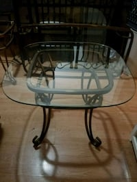 round glass top table with brushed metal base Anchorage