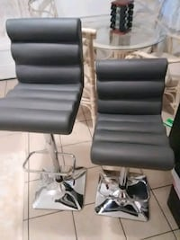 two gray leather padded rolling chairs Winter Haven, 33881