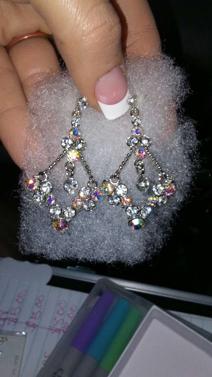 assorted rhinestone studded silver earrings
