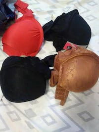 four several assorted color brassieres