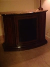 black CRT TV with brown wooden TV hutch New York, 10309
