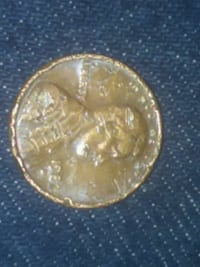 round gold-colored coin Resaca, 30735