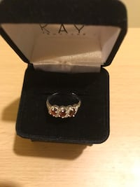 RING KAY JEWELRY GARNET RING. STERLING SILVER CAN BE RESIZED. NEW IN BOX 165 mi