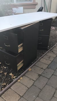 two black 2-drawer filing cabinets