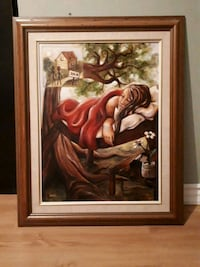 brown wooden framed painting of woman