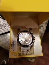 round Invicta chronograph watch with link b