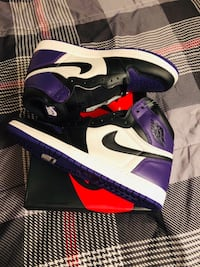 Pair of purple-and-white nike basketball shoes