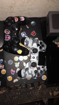 black and white Sony PS4 controllers