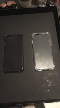 Two black and clear iphone cases