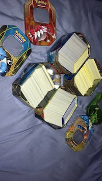 Assorted common and uncommon Pokémon cards about 400 per tin all very good condition  Toronto, M9P 1V1
