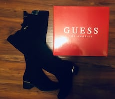 Guess knee high boots new in packaging never worn