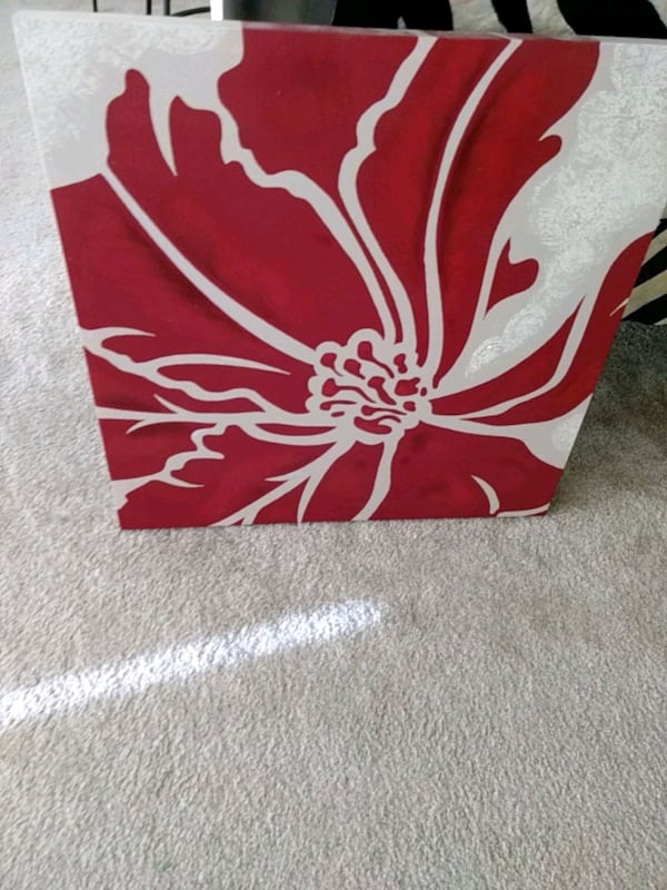 red and white floral textile 08aa8193-e055-47c1-b383-7aaff816b6ed