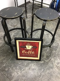 two black wooden barstools
