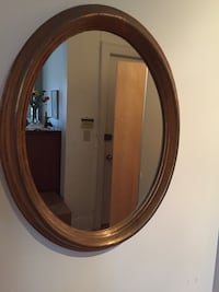 Golden oval wall mirror