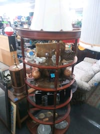 4 tiered red wood and glass half moon shelf.