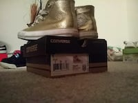 pair of gold Converse high-tops sneakers with box