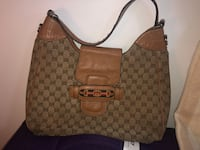 Real authentic Gucci women's purse 1990's Calgary, T2J 3C8