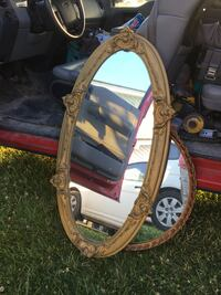 Antique Large oval ornate mirror