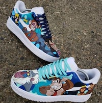 pair of blue-and-white Nike sneakers Tecumseh