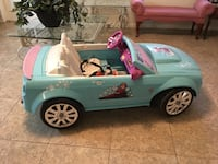 "Frozen battery operated car.  Almost like new.  Radio plays ""Let it go"""