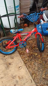 toddler's red and blue Spider-Man bicycle