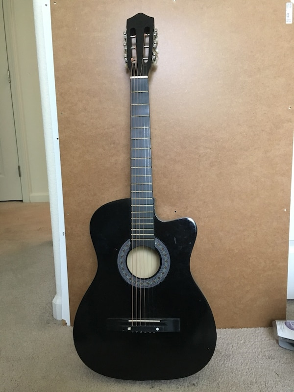black and brown classical guitar
