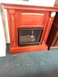 brown wood-framed electric fireplace