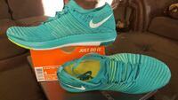 New pair of green Nike shoes with box Markham, L6C 3H7
